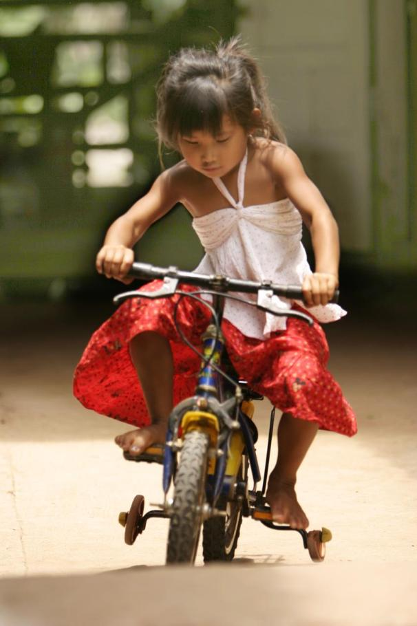 Laotian Girl riding bike